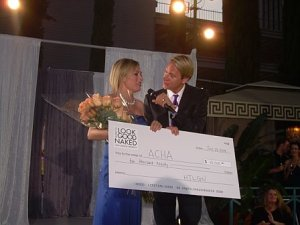 Carson presents Heather with a $10,000 check!